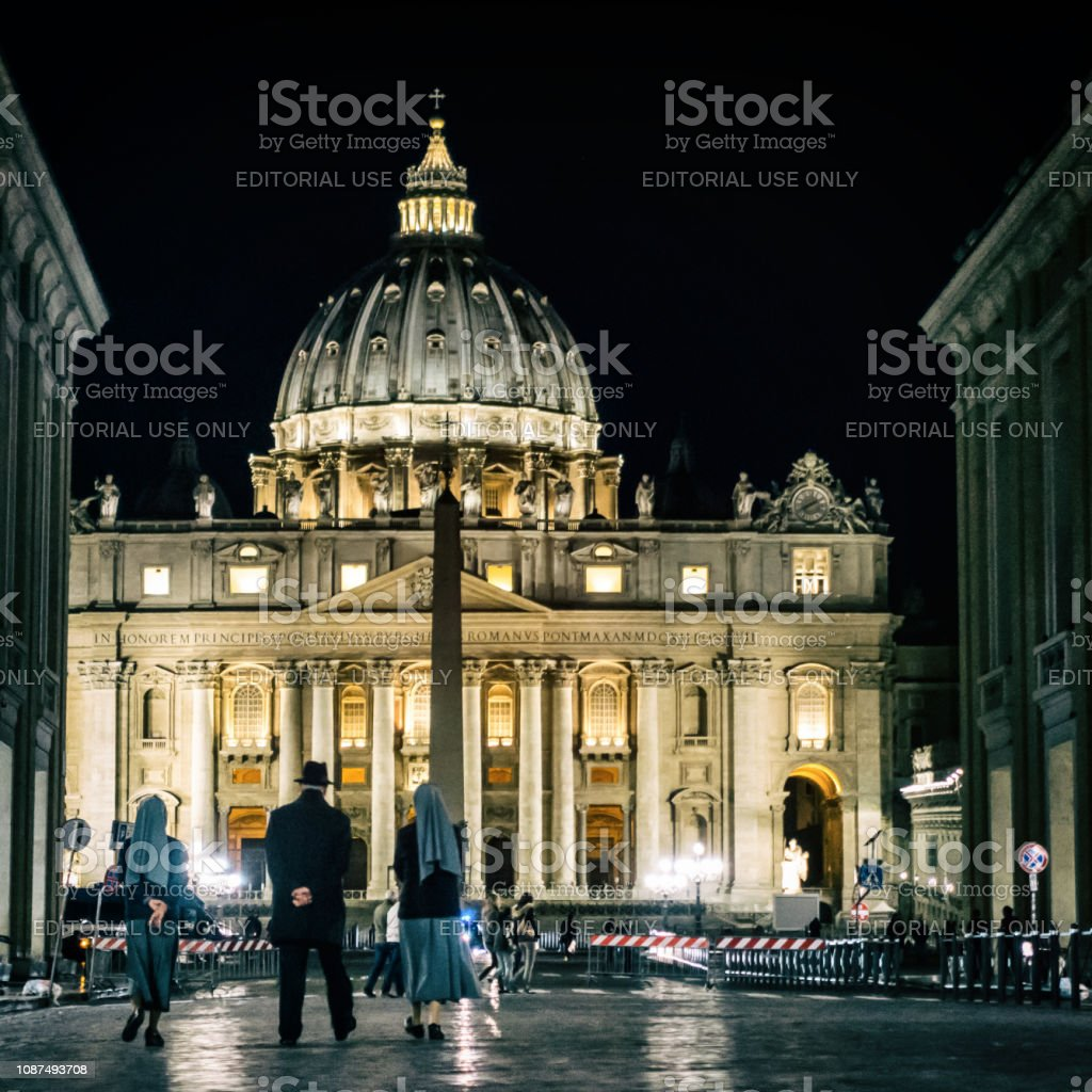 priest and nuns walking at night to vatican. Rome stock photo