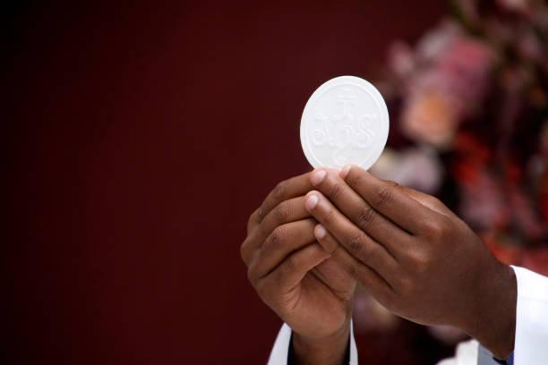 Priest celebrate mass at the church stock photo