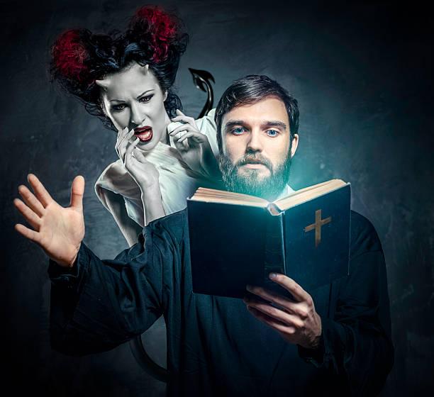 Priest evicting demons stock photo