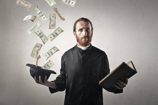 priest gets some money - preacher stock photos and pictures