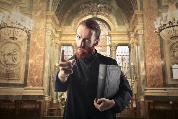 priest in a church - preacher stock photos and pictures