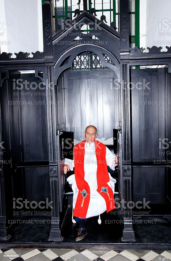 Priest in confession boot stock photo