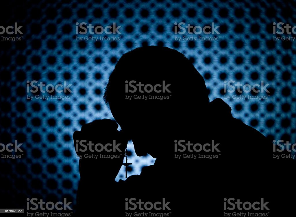 Priest in Confession Booth with Cross stock photo