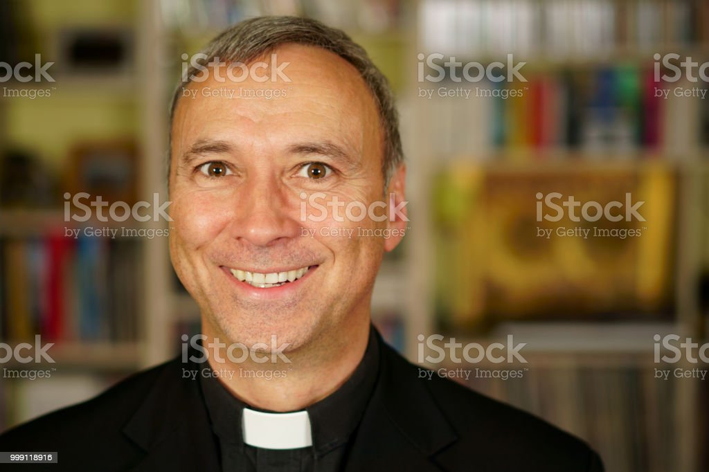 Priest in his library. stock photo