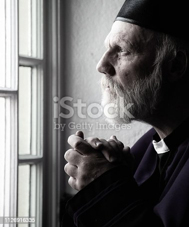 Priest in prayer