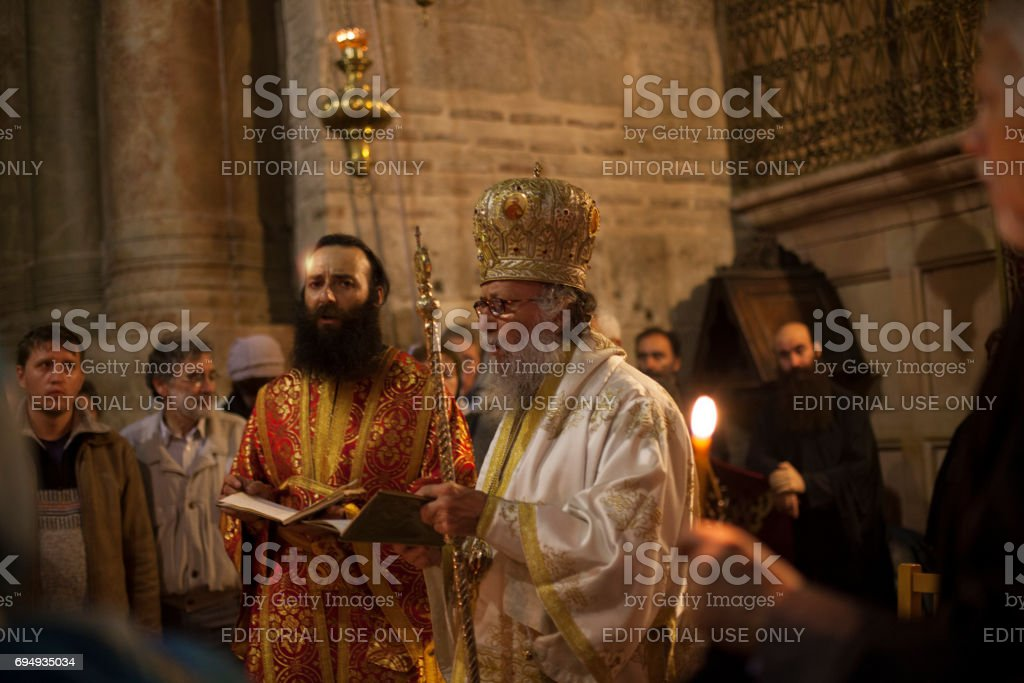 Priest in the Holy Sepulchre Church stock photo