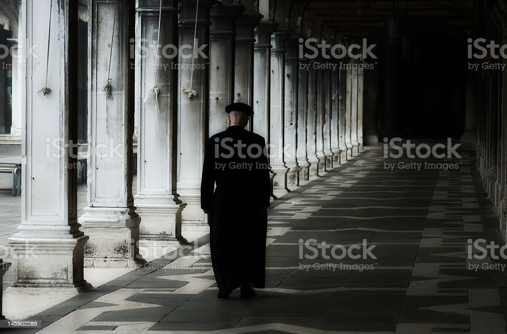Priest in Venice, San Marco Square stock photo