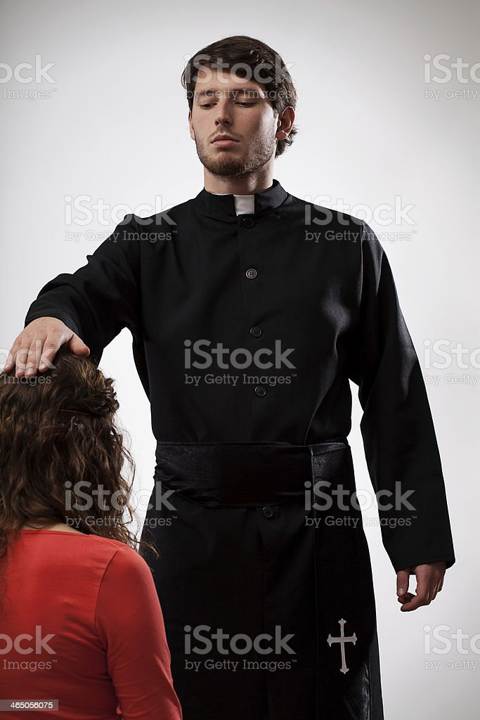 Priest is blessing a believer stock photo