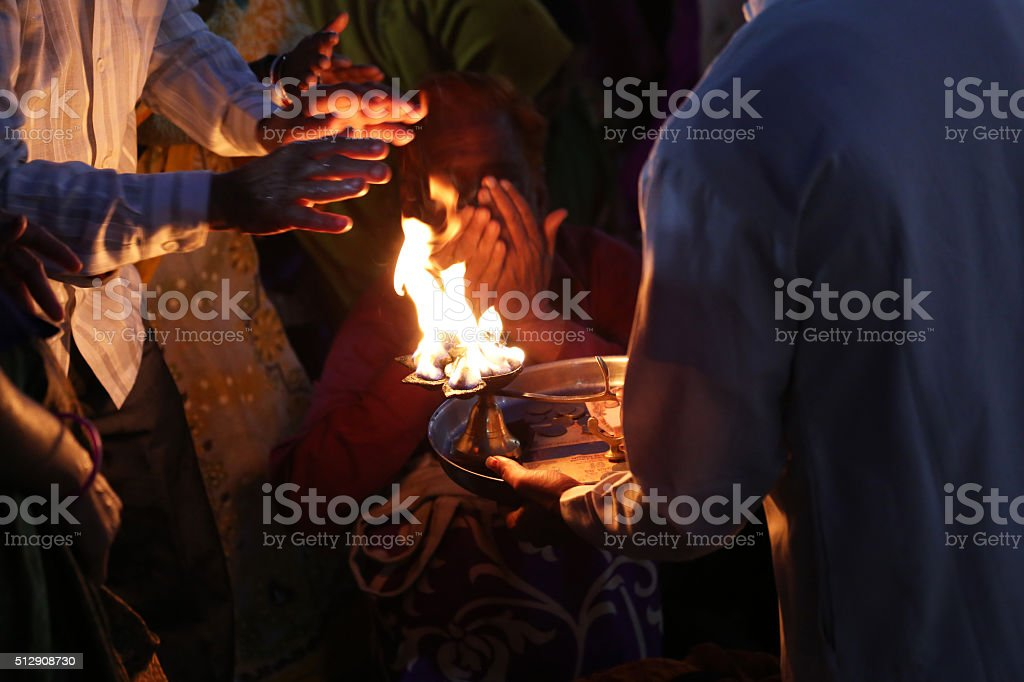 Priest performs religious Ganga Aarti ceremony at Har Ki Pauri