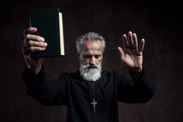 priest - preacher stock photos and pictures