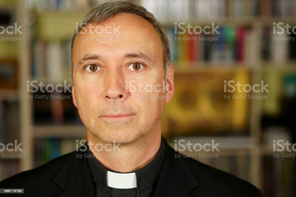 Priest poker face stock photo