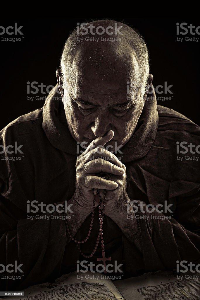 priest praying royalty-free stock photo
