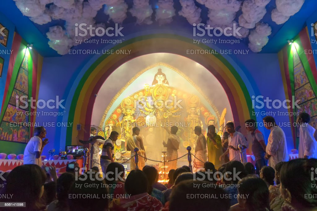 Priest praying to Goddess Durga at Durga Puja festival stock photo
