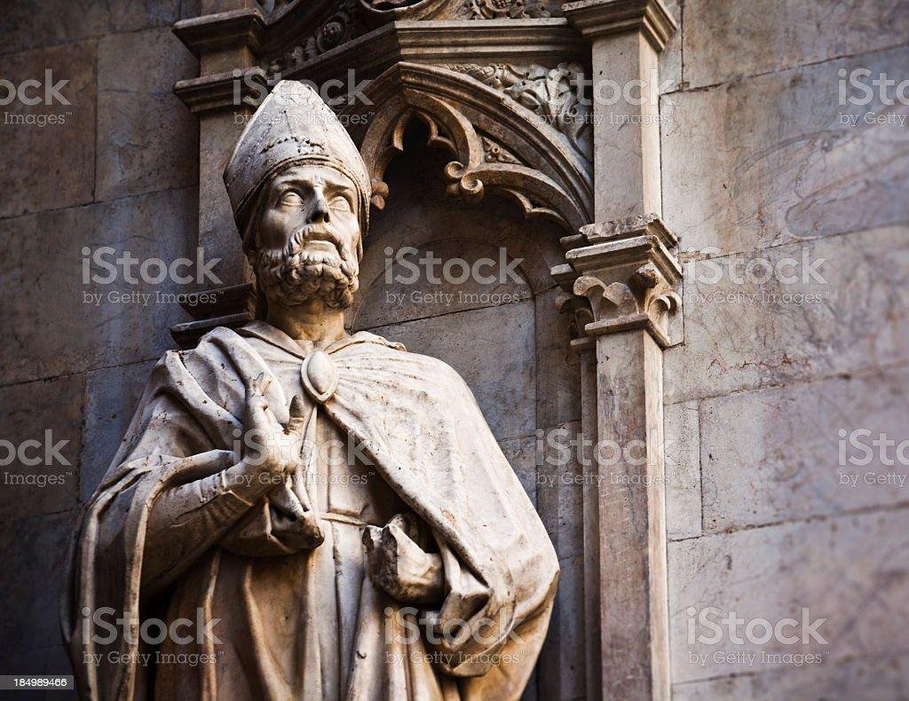 Priest statue stock photo