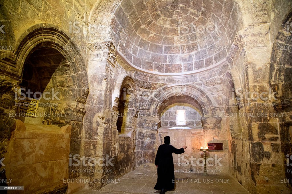 Priest who is praying in Deyrulzafaran Monastery. royalty-free stock photo