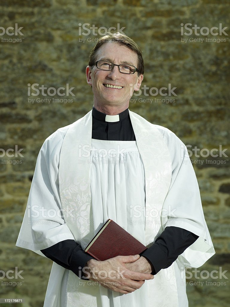 Priest with Bible stock photo