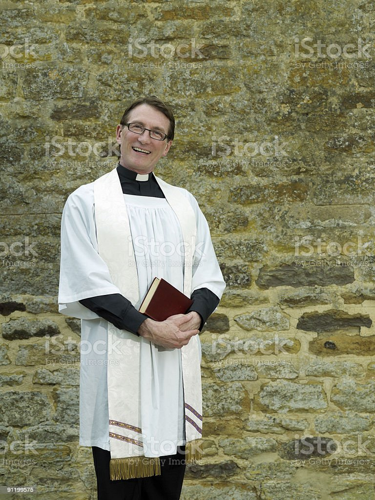 Priest with Bible royalty-free stock photo