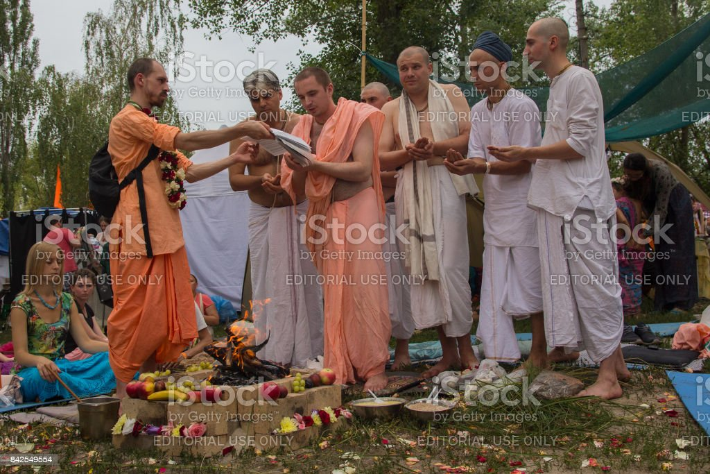 Priests perform the Vedic ritual at the festival 'Vedalife' stock photo
