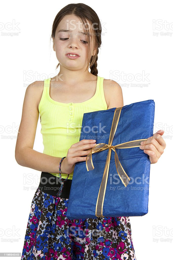 Primary Age Girl Disappointed to Receive a Gift stock photo