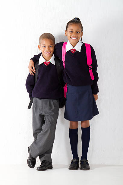 primary pupils - uniform stock photos and pictures
