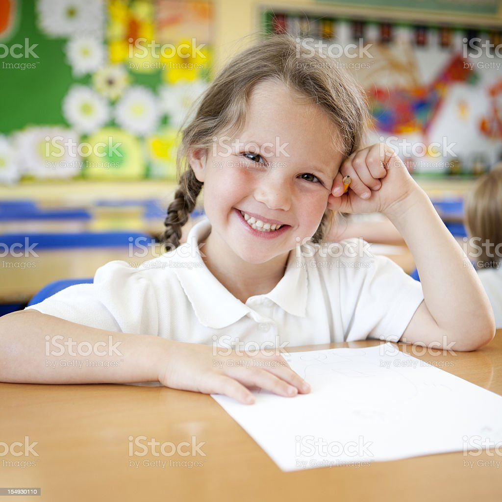 primary school: bright smile from happy young schoolgirl in class royalty-free stock photo