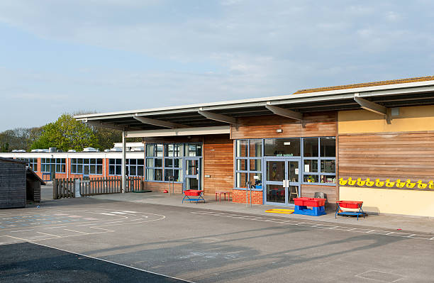 primary school building in kent, united kingdom - recess stock photos and pictures