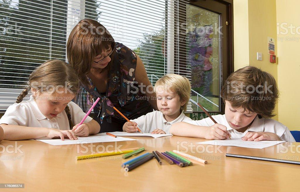 primary school: classroom assistance stock photo