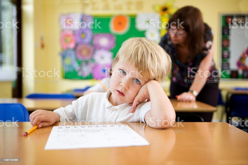 primary school: confused schoolboy royalty-free stock photo