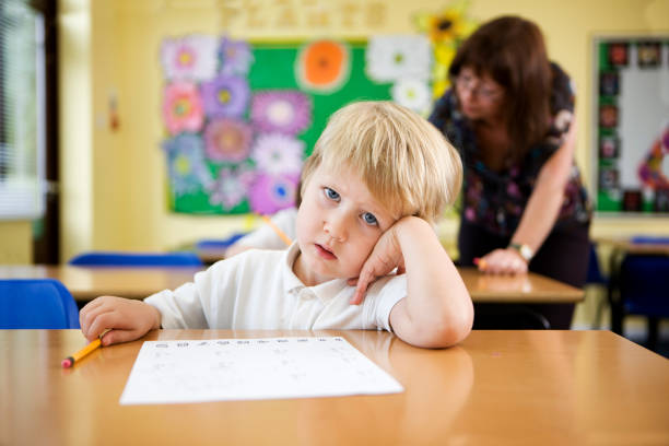 primary school: confused schoolboy  illiteracy stock pictures, royalty-free photos & images