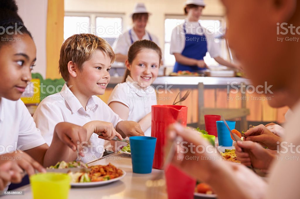 Primary School Kids At A Table In School Cafeteria Close Up Stock ...