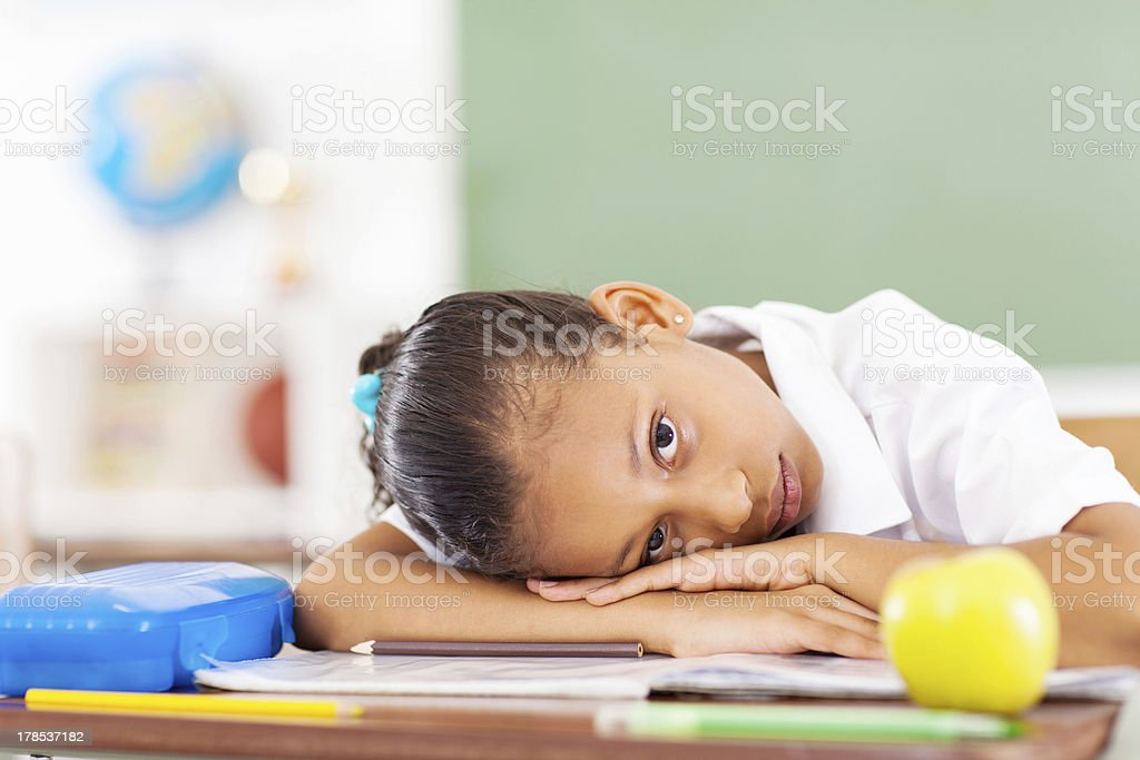 primary schoolgirl resting stock photo