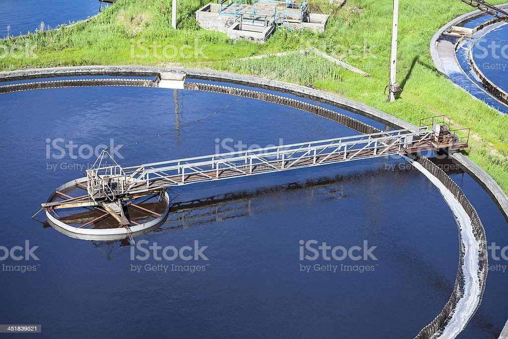 Primary sedimentation basin, sewage flowing through large tanks stock photo