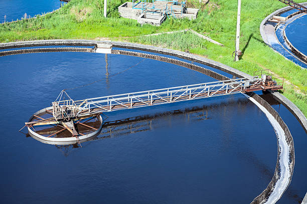 Primary sedimentation basin, sewage flowing through large tanks Primary sedimentation basin, sewage flowing through large tanks_ sewage treatment plant stock pictures, royalty-free photos & images