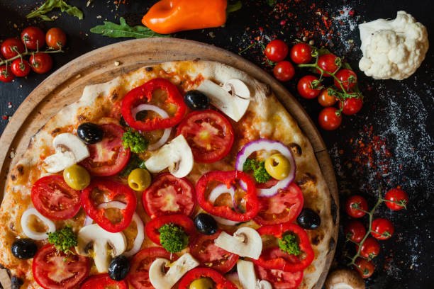 primavera pizza vegetables healthy food ingredient primavera pizza background. Healthy vegetable ingredients. Delicious traditional italian food concept primavera stock pictures, royalty-free photos & images