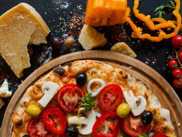 primavera pizza vegetables healthy food ingredient primavera pizza background. Delicious traditional italian recipe concept primavera stock pictures, royalty-free photos & images