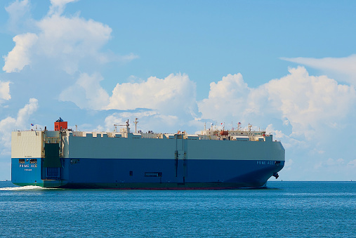 """Tangier Island, Virginia / USA - June 21, 2020: The """"Prime Ace"""" vehicles carrier ship plies the Chesapeake Bay on its way to Baltimore, Maryland, to pick up its next load of cargo."""
