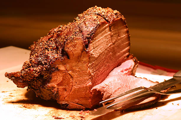 Prime Rib Shot of prime rib at a buffet table. Shallow DOF. roasted prime rib stock pictures, royalty-free photos & images