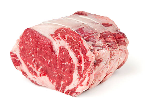 Prime Rib Roast Prime rib roast - Prime rib roast on white with clipping path.  Please see my portfolio for other food related images. roasted prime rib stock pictures, royalty-free photos & images
