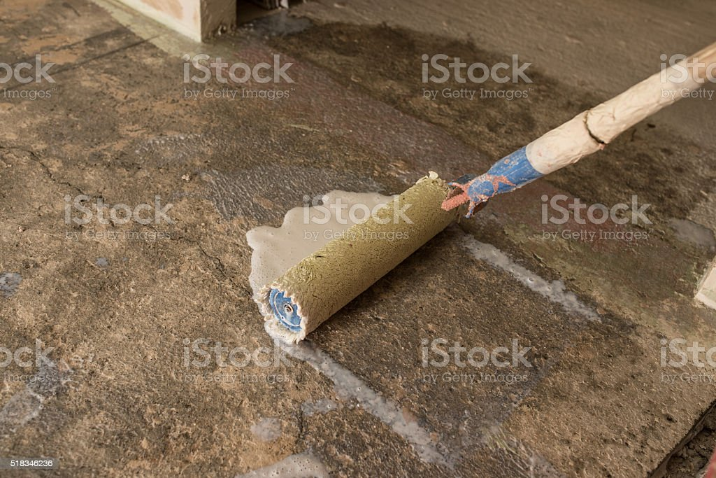 primer concrete floor for waterproofing stock photo