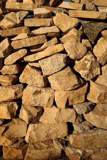 primitive stone wall - adomer stok fotoğraflar ve resimler
