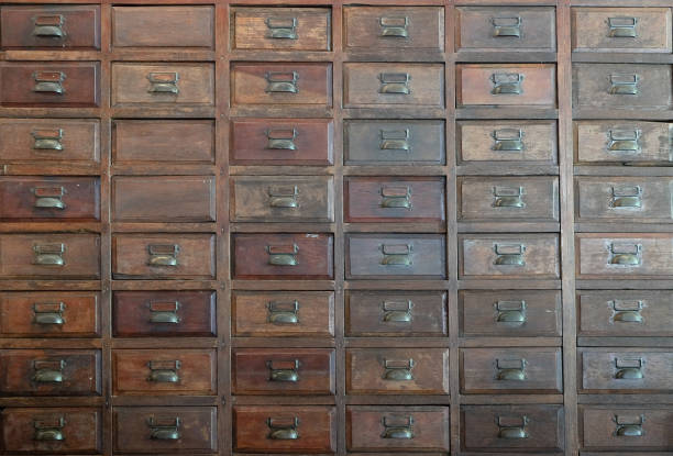 primitive wooden apothecary or catalog cabinet stock photo