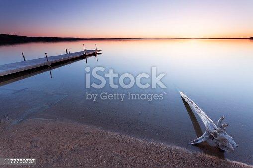 First light hitting the shore. Prince Albert National Park, Saskatchewan, Canada. Image taken from a tripod.