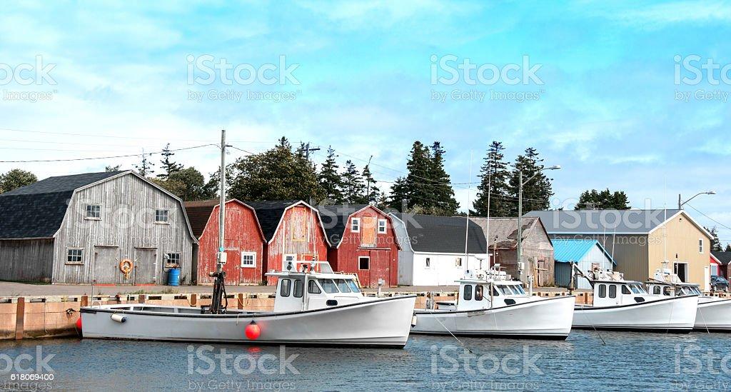 Prince Edward Island fishing village- boats, storage sheds, homes stock photo