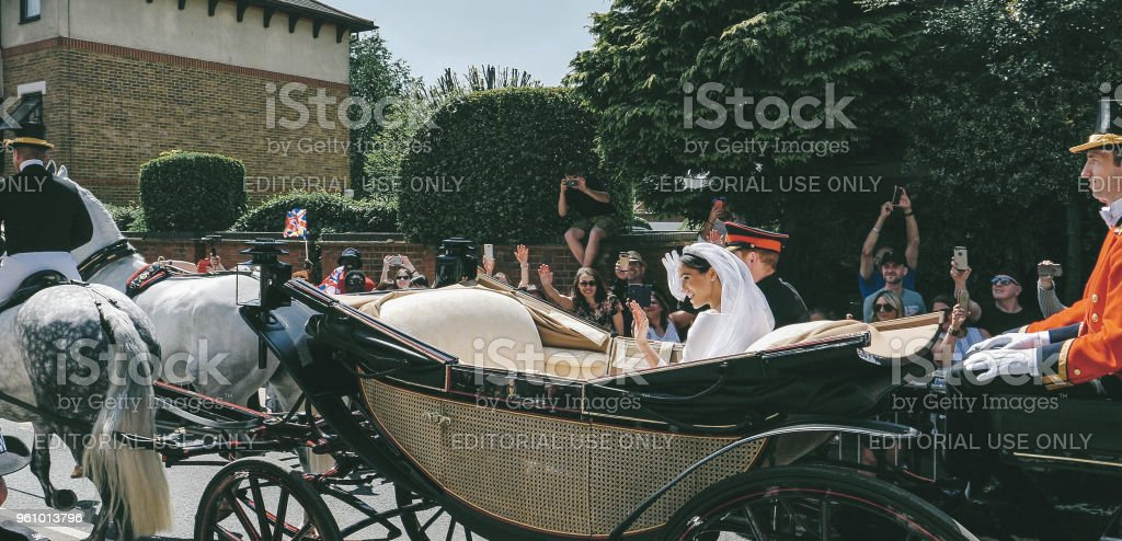 Prince Harry, Duke of Sussex and Meghan, Duchess of Sussex leave Windsor Castle - Стоковые фото 2018 роялти-фри