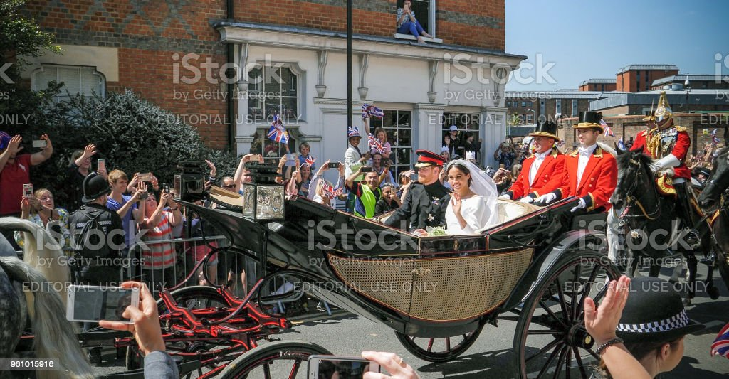 Prince Harry, Duke of Sussex and Meghan, Duchess of Sussex leave Windsor Castle - Foto stock royalty-free di 2018
