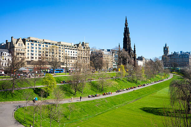 Princes Street Gardens, Edinburgh Princes Street Gardens on a sunny day.  Scott Monument is in the background.  The park is filled with people. princes street edinburgh stock pictures, royalty-free photos & images
