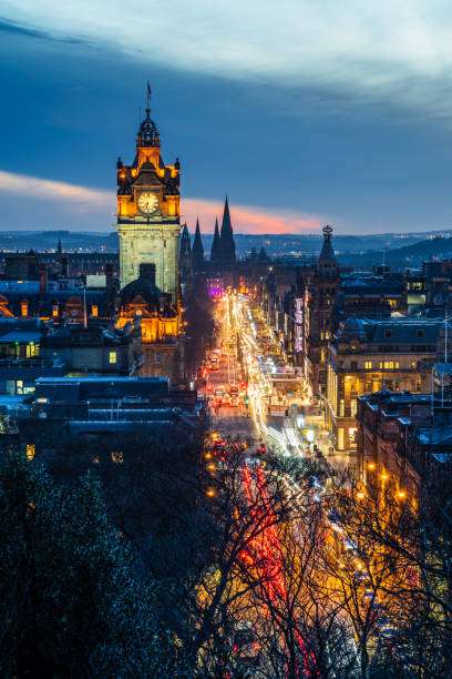 Princes street in Edinburgh with light trails at Dusk View of Princes Street from Calton Hill at Dusk. Edinburgh, Scotland, UK. princes street edinburgh stock pictures, royalty-free photos & images