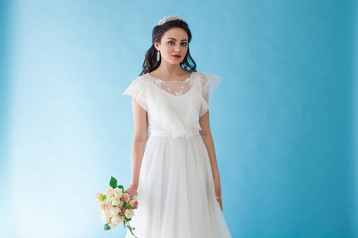 674214372 istock photo Princess Bride in a white dress with a Crown on a blue background 674212812