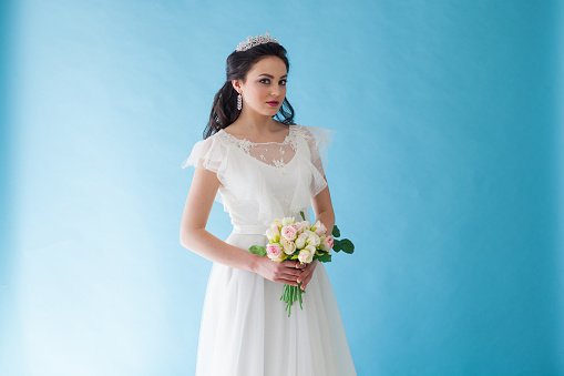 674214372 istock photo Princess Bride in a white dress with a Crown on a blue background 674213234
