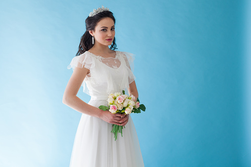 674214372 istock photo Princess Bride in a white dress with a Crown on a blue background 674213452